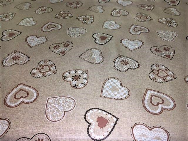 A vinyl wipe clean tablecloth called Lovehearts beige in a 54 inch wide