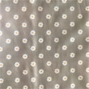 White daisy on grey vinyl tablecloth