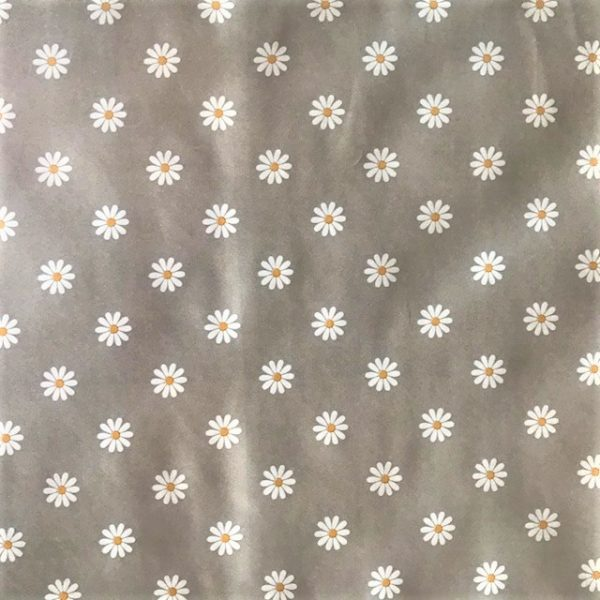 White daisy on grey vinyl tablecloth