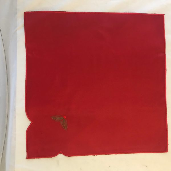 A pack of 4 red table napkin to go with Christmas Spruce tree tablecloth